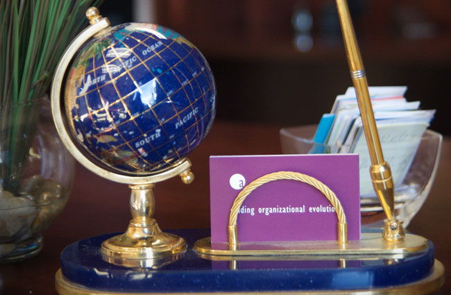 Globe and business card holder image.